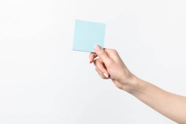 cropped shot of woman holding blank blue sticky note in hand isolated n white