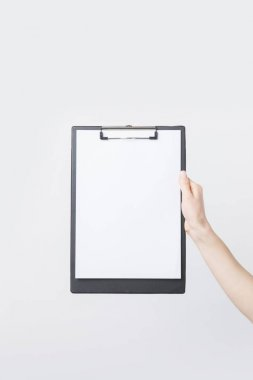 partial view of woman holding blank clipboard in hand isolated on white