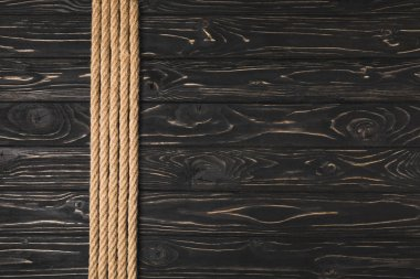 top view of brown nautical ropes placed in row on wooden tabletop