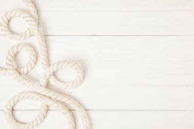 top view of white nautical rope on wooden surface