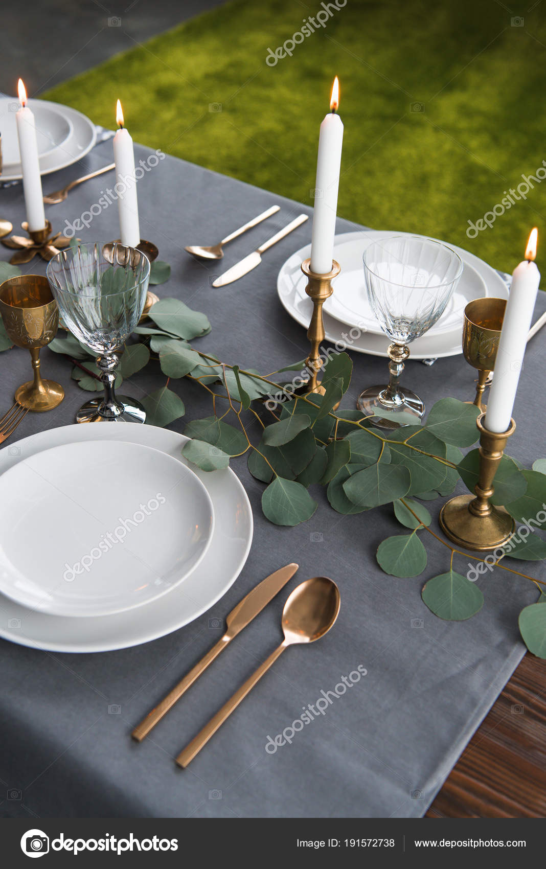 Close up view of rustic table setting with eucalyptus vintage tarnished cutlery candles in candle holders and empty plates u2014 Photo by AntonMatyukha & Close View Rustic Table Setting Eucalyptus Vintage Tarnished Cutlery ...