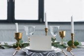 Fotografie close up view of empty card on plates on tabletop with beautiful rustic setting for guests