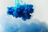 Zár megjelöl kilátás összekeverése kék és türkiz tinta fröccsenő víz elszigetelt szürke