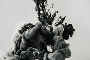 close up view of mixing gray smoke isolated on gray