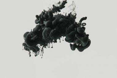 Close up view of black ink in water isolated on gray