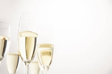 closeup view of champagne glasses isolated on white background