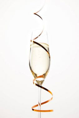 champagne glass wrapped by ribbon isolated on white background, holiday concept