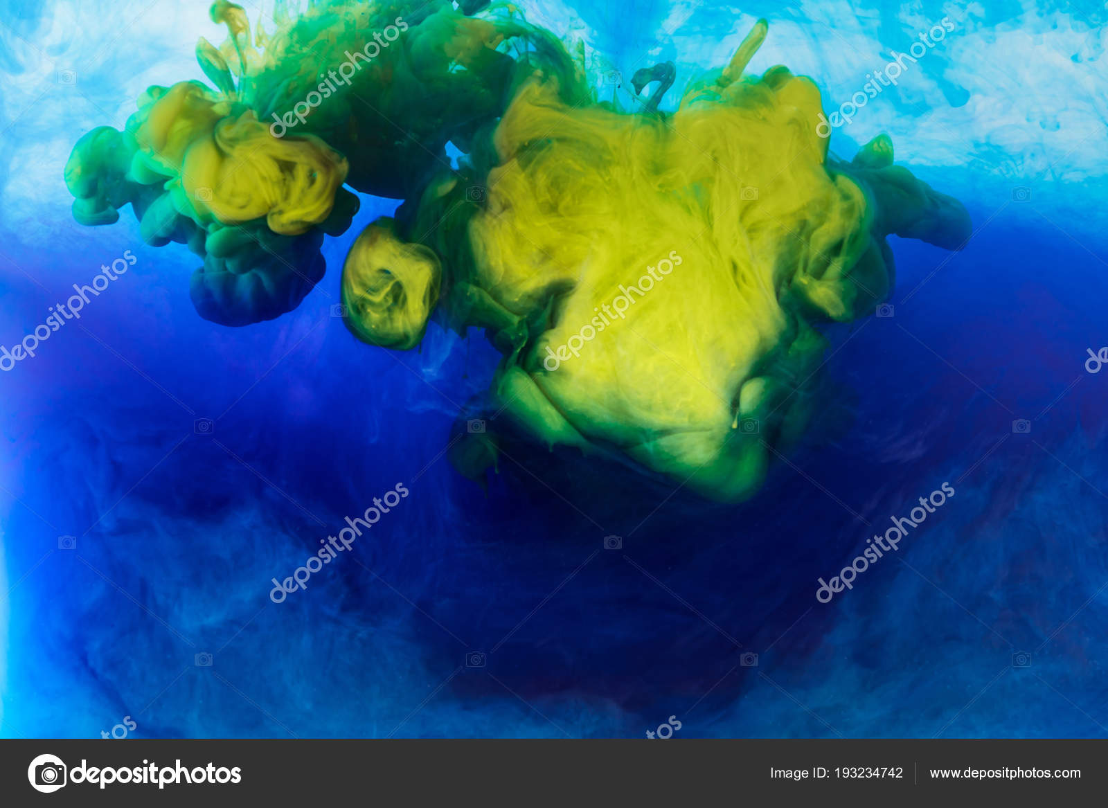 abstract background blue yellow paint mixing water stock photo