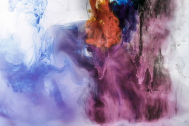creative background with blue and violet flowing paint in water