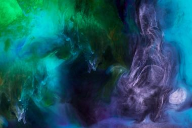 Smoky wallpaper with blue, purple and green paint swirls looks like space stock vector