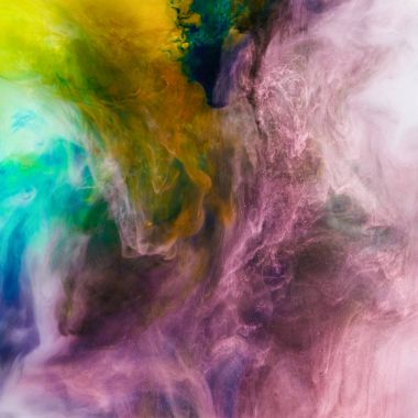 creative texture with pink, orange and green flowing paint, looks like space