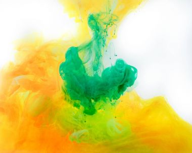 smoky background with green and orange paint flowing in water