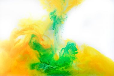 Abstract background with green and orange paint swirling in water stock vector