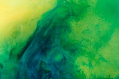 artistic background with green paint flowing in water