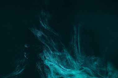 abstract artistic background with turquoise paint flowing on black