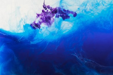 Creative background with flowing blue and purple paint in water stock vector