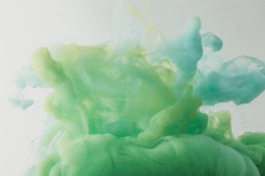 light texture with flowing turquoise and green paint in water, isolated on grey