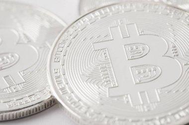 close-up shot of pile silver bitcoins