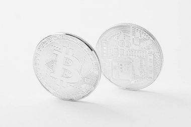 Close-up shot of bitcoins on white surface stock vector