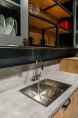 Interior of modern kitchen with metal sink