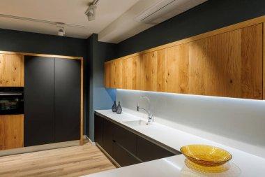 Stylish kitchen with modern white counter