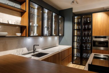 Renovated kitchen interior with glass cabinets