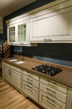 Renovated kitchen interior with stove and sink