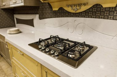 Stylish kitchen with stove on white counter