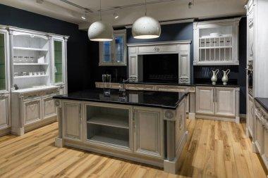 Renovated kitchen interior in dark tones