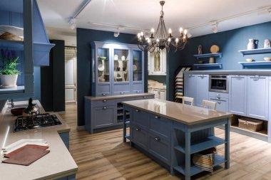 Renovated kitchen interior in blue tones