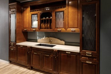 Renovated kitchen interior with wooden cabinets and sink