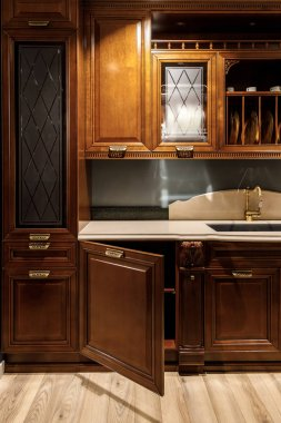 Renovated kitchen interior with stylish wooden cabinets