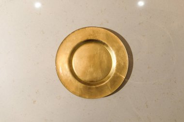 Golden metal plate on light table