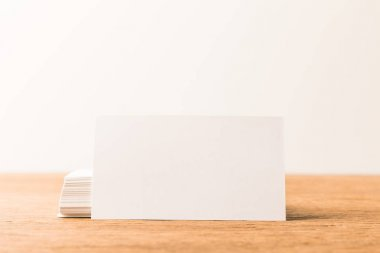 close up view of blank cards on wooden surface on grey backdrop