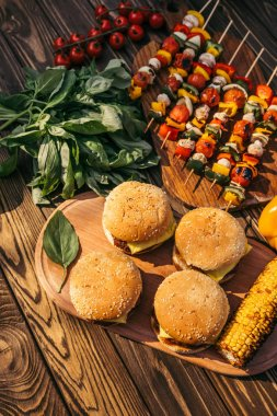 Dinner with hamburgers cooked outdoors on grill