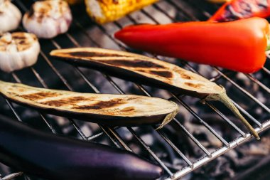 Vegetables and garlic cooked outdoors on grill