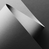 close-up view of grey empty paper sheet abstract background