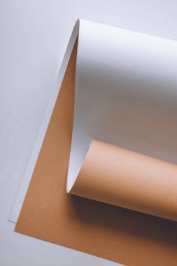 empty white and brown paper sheets on grey background