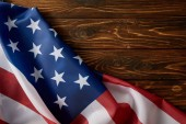 Fotografie partial view of united states of america flag on wooden surface