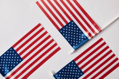 top view of united states of america flagpoles on white surface