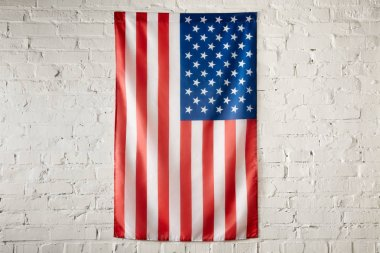 close up view of united states of america flag on white brick wall