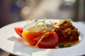 delicious eggplant caviar with tomato and butter served in restaurant in sunlight