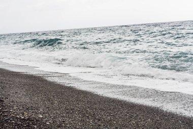 sea waves on sandy beach in coastline