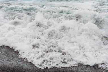 White sea foam on sandy beach stock vector