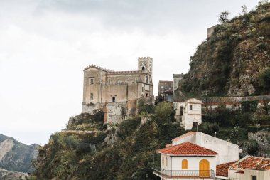 SAVOCA, ITALY - OCTOBER 3, 2019: Church of San Nicolo on hill near small houses stock vector