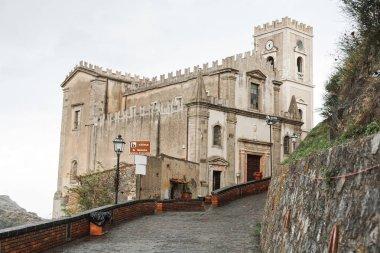 SAVOCA, ITALY - OCTOBER 3, 2019: Church of San Nicolo near paving stones on road stock vector