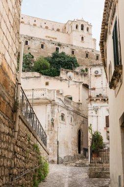 SCICLI, ITALY - OCTOBER 3, 2019: selective focus of San Matteo church near buildings in italy stock vector