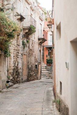 selective focus of narrow street in ragusa, italy