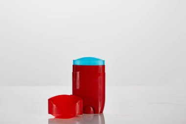 red roll on bottle of deodorant isolated on white
