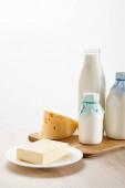 Fotografie various fresh organic dairy products on wooden board isolated on white